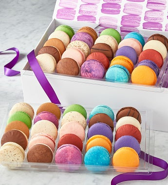 Macarons -50 Pc Box - Deluxe These macarons are amazing!  Dana's Bakery has taken the traditional French Macaron to a new level by creating uniquely American flavors inspired by classic desserts, pastries, candy and sweet treats! From Red Velvet to S'mores, Fruity Cereal, to Peanut Butter & Jelly, these all-American favorites are destined to please even the most discriminating!  Choose from the 12 piece assortment that arrives in an adorable reusable insulated bag or wow them even further with the ribboned gift box in 3 sizes:  25pc, 50pc, or 100pc.  Gluten free too! - made with almond flour. Makes a great gift for one or for a large party!Kosher, OU D.12 piece acetate box with reusable insulated bagS'mores, Molten Chocolate, Orange Creamsicle, Peanut Butter & Jelly, Red Velvet, Cookie Dough,Strawberry Shortcake, Birthday Cake, Cafe Mocha, Fruity Cereal, Key Lime Pie, Cotton Candy25 piece ribboned gift boxContains 2 each of the following flavors plus one Raspberry JamS'mores, Molten Chocolate, Orange Creamsicle, Peanut Butter & Jelly, Red Velvet, Cookie Dough,Strawberry Shortcake, Birthday Cake, Cafe Mocha, Fruity Cereal, Key Lime Pie, Cotton Candy50 piece ribboned gift boxContains 4 each of the following flavors plus 2 Raspberry JamS'mores, Molten Chocolate, Orange Creamsicle, Peanut Butter & Jelly, Red Velvet, Cookie Dough,Strawberry Shortcake, Birthday Cake, Cafe Mocha, Fruity Cereal, Key Lime Pie, Cotton Candy100 piece ribboned gift boxContains 8 each of the following flavors plus 4 Raspberry JamS'mores, Molten Chocolate, Orange Creamsicle, Peanut Butter & Jelly, Red Velvet, Cookie Dough,Strawberry Shortcake, Birthday Cake, Cafe Mocha, Fruity Cereal, Key Lime Pie, Cotton Candy