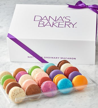 Macarons -25 Pc Box These macarons are amazing!  Dana's Bakery has taken the traditional French Macaron to a new level by creating uniquely American flavors inspired by classic desserts, pastries, candy and sweet treats! From Red Velvet to S'mores, Fruity Cereal, to Peanut Butter & Jelly, these all-American favorites are destined to please even the most discriminating!  Choose from the 12 piece assortment that arrives in an adorable reusable insulated bag or wow them even further with the ribboned gift box in 3 sizes:  25pc, 50pc, or 100pc.  Gluten free too! - made with almond flour. Makes a great gift for one or for a large party!Kosher, OU D.12 piece acetate box with reusable insulated bagS'mores, Molten Chocolate, Orange Creamsicle, Peanut Butter & Jelly, Red Velvet, Cookie Dough,Strawberry Shortcake, Birthday Cake, Cafe Mocha, Fruity Cereal, Key Lime Pie, Cotton Candy25 piece ribboned gift boxContains 2 each of the following flavors plus one Raspberry JamS'mores, Molten Chocolate, Orange Creamsicle, Peanut Butter & Jelly, Red Velvet, Cookie Dough,Strawberry Shortcake, Birthday Cake, Cafe Mocha, Fruity Cereal, Key Lime Pie, Cotton Candy50 piece ribboned gift boxContains 4 each of the following flavors plus 2 Raspberry JamS'mores, Molten Chocolate, Orange Creamsicle, Peanut Butter & Jelly, Red Velvet, Cookie Dough,Strawberry Shortcake, Birthday Cake, Cafe Mocha, Fruity Cereal, Key Lime Pie, Cotton Candy100 piece ribboned gift boxContains 8 each of the following flavors plus 4 Raspberry JamS'mores, Molten Chocolate, Orange Creamsicle, Peanut Butter & Jelly, Red Velvet, Cookie Dough,Strawberry Shortcake, Birthday Cake, Cafe Mocha, Fruity Cereal, Key Lime Pie, Cotton Candy