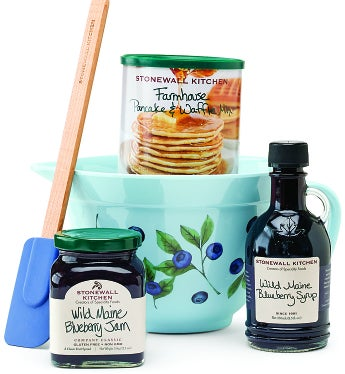 "Stonewall Kitchen Blueberry Batter Bowl Gift Start their special day in a gourmet way with this tasteful Breakfast Batter Bowl Gift featuring exceptional Stonewall Kitchen® specialty foods. Inspired by the tasty fare served on crisp New England mornings, we've filled this classic batter bowl with a variety of delicacies they'll love to wake up to, including fluffy Farmhouse Pancake and Waffle Mix, rich Wild Maine Blueberry Syrup, and Wild Maine Blueberry Jam. Stonewall Kitchen® has built its reputation by consistently creating items of the highest quality in the most exciting flavor profiles—they'll taste the difference.Stonewall Kitchen was founded by two farmer's market artisans based on ideals born out of Maine: unspoiled beauty, wholesomeness, a sense of community. Their twenty year reign at the top of the specialty food industry's annual SOFI awards is a testament to their true devotion to unique and time honored flavor profiles made with wholesome, quality and tasty ingredients.  If you really produce a high quality item, you'll be successful.  That's the secret according to Jim and Jonathan.Blueberry Pattern Melamine Batter Bowl with HandleBlue Stonewall Kitchen® Signature Spatula with Wood HandleStonewall Kitchen® Wild Maine Blueberry JamStonewall Kitchen® Farmhouse Pancake and Waffle MixStonewall Kitchen® Wild Maine Blueberry SyrupnMeasures 11""L x 11""W x 12""H"