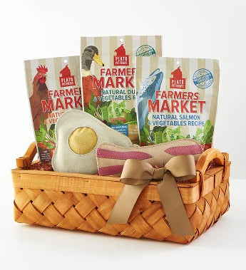 Max & Milo™ Farmers Market Dog Treats & Toys Gift A taste of country life! A large handsome woven basket holds toys & treats to keep a special pooch happy. At sunrise nothing is better than bacon & eggs chewy toys! Our heavy duty toys are made of eco- friendly suede. Doggie will gobble up the slow roasted grain-free meat & veggie treats -- chicken, duck & salmon. Tied with a grosgrain ribbon.Toys are 100% Natural - Sustainable Materials. Treats are All-Natural, NO artificial preservatives, flavors, gluten or GMO's.Wood Slat Woven Basket with Wood Handles tied with a grosgrain ribbonPlato® Farmers Market Chicken & Vegetables Grain-Free Dog TreatsPlato® Farmers Market Duck & Vegetables Grain-Free Dog TreatsPlato® Farmers Market Salmon & Vegetables Grain-Free Dog TreatsBacon Dog ToyFried Egg Dog ToynMeasures  15.25 L x 9.125 W x 6.25 H