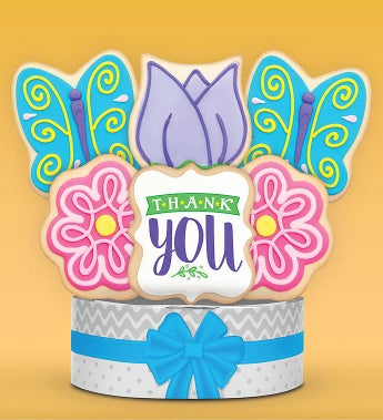 Thank You Butterfly Garden Cookie Bouquet 6 Pc by 1-800-Baskets Say Thank You! in a big way with this beautiful & delicious butterfly garden cookie bouquet. These unique buttery shortbread cookies are hand decorated with candy-like royal icing, and individually wrapped with care. This impressive gift will really show your appreciation.